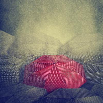 Artistic Image of Red Umbrella Standing out from the Crowd
