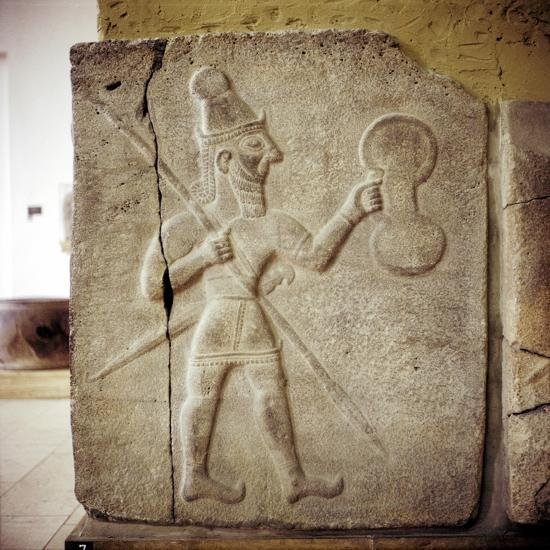 Hittite relef of a Hittite warrior or war-god with shield spear and sword. Artist: Unknown-Unknown-Giclee Print