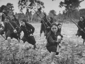 Hoa Hao Women's Troops Training for Jungle War with Sabers, in French Indo China