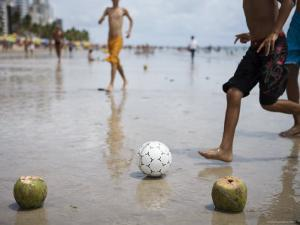 Boys Playing Beach Football with Coconut Goal Posts by Holger Leue