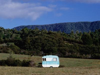 Caravan and a Cow in Field, Near Waima