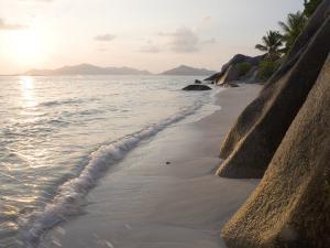 Coastline at Sunset, La Digue Island by Holger Leue