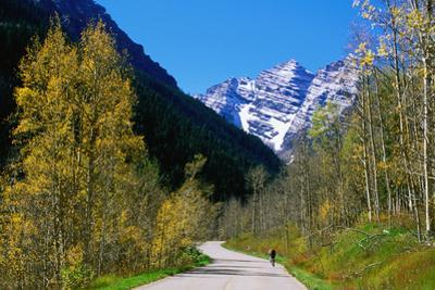 Cyclist on Road to Maroon Bells, Aspen, Colorado, United States of America, North America
