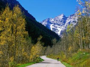 Cyclist on Road to Maroon Bells, Aspen, Colorado by Holger Leue