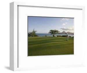 Men Playing Golf on Le Touessrok Golf Course by Holger Leue