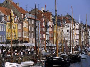 Nyhavn Boats and Cafes, Copenhagen, Denmark by Holger Leue