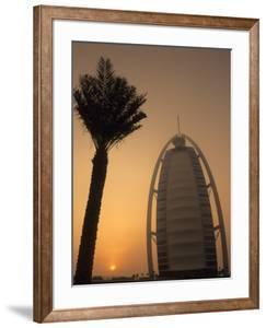 Palm Tree Next to Burj Al Arab Hotel at Sunset, Dubai, United Arab Emirates by Holger Leue