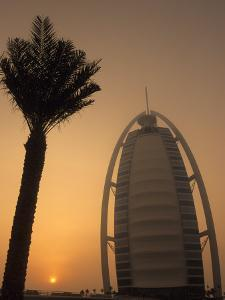 Palm Tree Next to Burj Al Arab Hotel at Sunset, Dubai, United Arab Emirates by Holger Leue