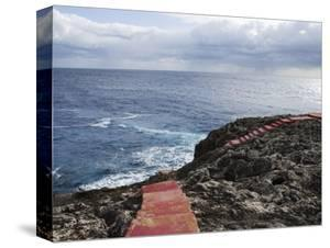 Red Stairs on Black Rocks by Holger Leue