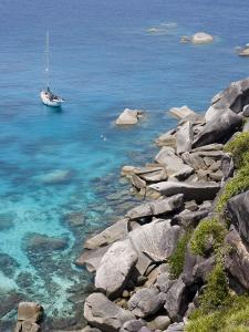 Sailboat and Snorkelers Near Granite Rocks by Holger Leue