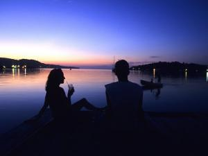 Silhouetted Couple at Dusk at Huntress Marina, Port Antonio, Jamaica by Holger Leue