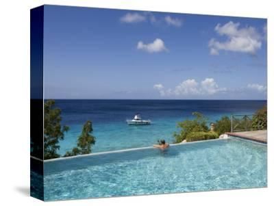 Swimmer in Infinity Pool at Habitat Curacao Dive Resort Near St. Willibrordus
