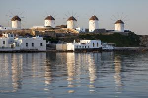 Greece, Mykonos, windmills and their reflection in the water by Hollice Looney