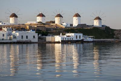 Greece, Mykonos, windmills and their reflection in the water