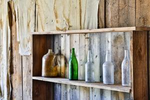 USA, Montana, Bannack State Park, Old Bottles on a Shelf by Hollice Looney