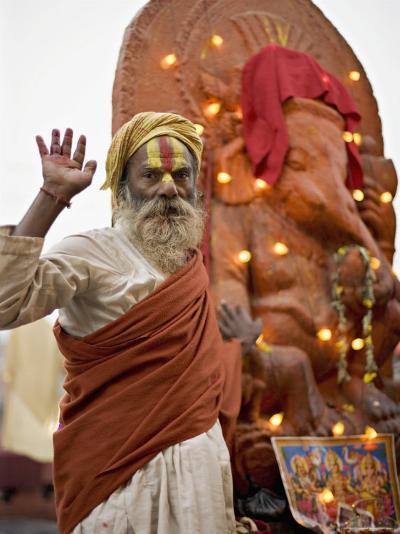 Holy Man in Front of a Ganesh Statue Draped in Fairy Lights at the Hindu Festival of Shivaratri-Don Smith-Photographic Print