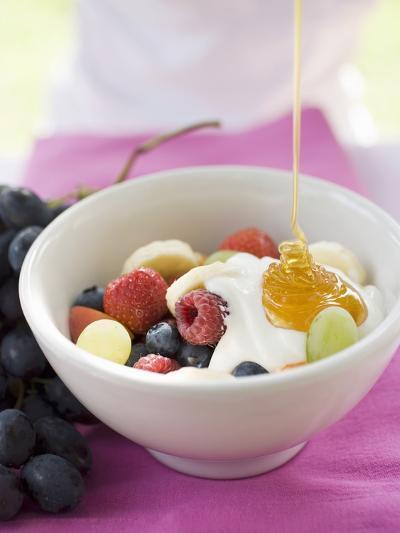 Honey Running onto Fruit Muesli with Yoghurt--Photographic Print