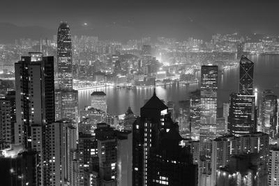 https://imgc.artprintimages.com/img/print/hong-kong-city-skyline-at-night-with-victoria-harbor-and-skyscrapers-illuminated-by-lights-over-wat_u-l-q103gut0.jpg?p=0