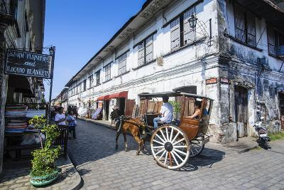 Horse Cart Riding Through the Spanish Colonial Architecture in Vigan, Northern Luzon, Philippines-Michael Runkel-Photographic Print