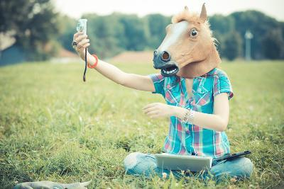 Horse Mask Unreal Hipster Woman Using Technology-Eugenio Marongiu-Photographic Print