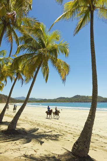 Horse Riders on Beautiful Palm Fringed Playa Carrillo-Rob Francis-Photographic Print