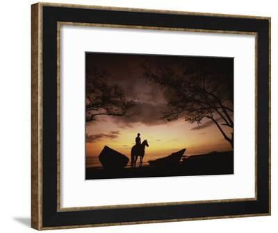 Horseback Rider Silhouetted on a Beach at Twilight, Costa Rica-Michael Melford-Framed Photographic Print