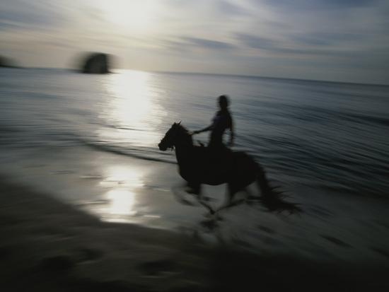 Horseback Rider Silhouetted on Beach, Costa Rica-Michael Melford-Photographic Print