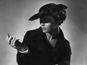 Vogue - February 1935 - Woman Holding a Compact Mirror by Horst P. Horst