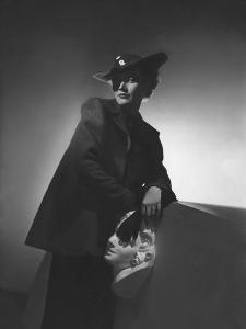 Vogue - March 1936 - Woman in Shadows Leaning on a Bust by Horst P. Horst