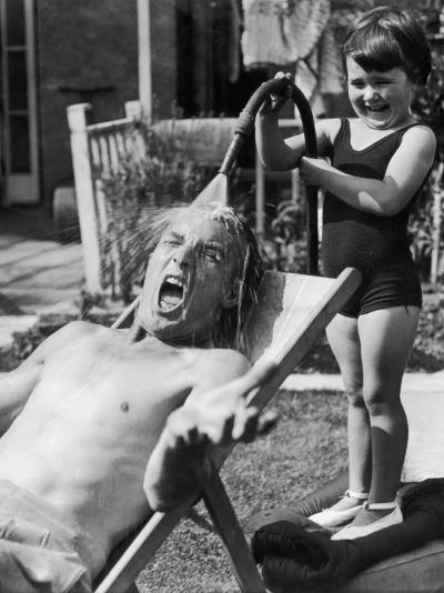 Hosing Down Dad--Photographic Print