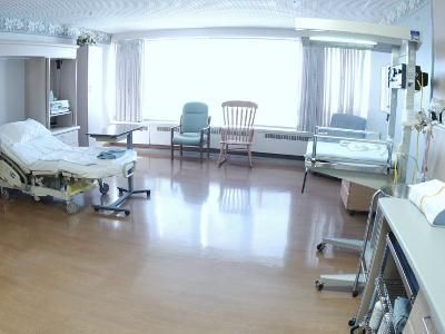 Hospital Bed, Chairs, and Medical Equipment Arranged in Empty Hospital Room--Photographic Print