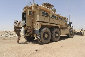 Hospital Corpsman Loads Up a Mine Resistant Ambush Protected Vehicle