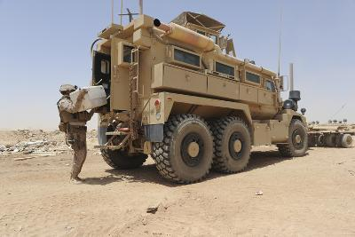 Hospital Corpsman Loads Up a Mine Resistant Ambush Protected Vehicle--Photographic Print