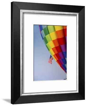 Hot air balloon bringing color to the sky.-Larry Ditto-Framed Photographic Print