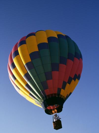 Hot Air Balloon in Flight-Paul Sutton-Photographic Print