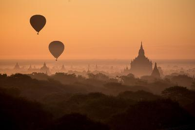 Hot Air Balloons Float Above the Terraces of a Buddhist Temple in Bagan-Cory Richards-Photographic Print