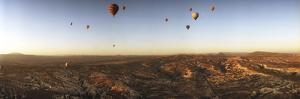 Hot Air Balloons over Landscape at Sunrise, Cappadocia, Central Anatolia Region, Turkey