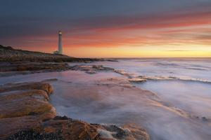 Wide Angle View of a Dramatic Sunset over the Slangkop Lighthouse at Kommetjie. Cape Peninsula, Wes by Hougaard Malan
