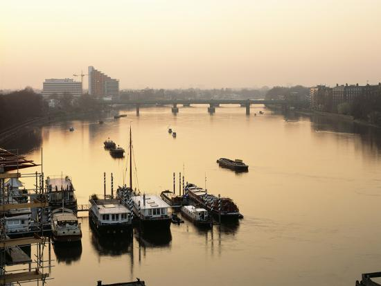 Houseboats Moored on River Thames with Putney Bridge at Sunset, Uk-Simon Warren-Photographic Print