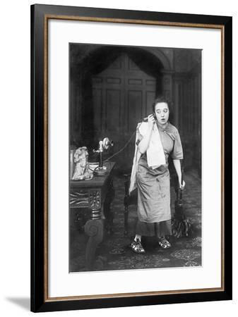 Housekeeper Looking Disheveled Listening on the Telephone--Framed Photo