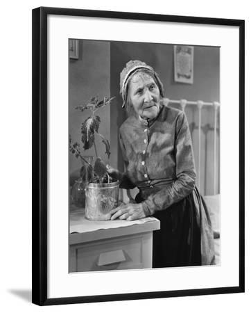 Housekeeper Tending to Plant--Framed Photo