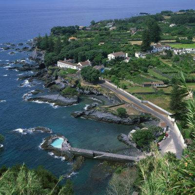 https://imgc.artprintimages.com/img/print/houses-and-rocky-coastline-in-the-south-of-the-island-of-sao-miguel-in-the-azores-portugal_u-l-p6kuea0.jpg?p=0