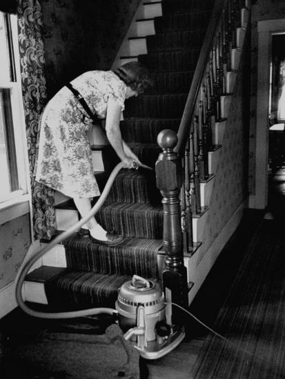Housewife Cleaning Her Carpet with Vacuum Cleaners-Yale Joel-Photographic Print