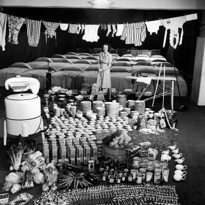 Housewife Marjorie McWeeney with Broom Amidst Display of Her Week's Housework, Bloomingdale's Store-Nina Leen-Photographic Print