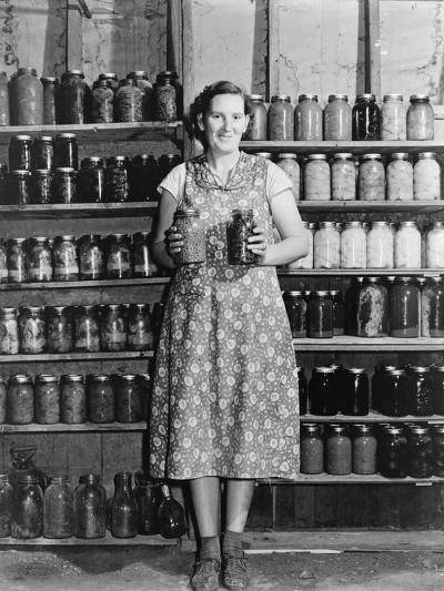 Housewife Proudly Displays Her Home Grown and Canned Food. Colorado, Sept. 1939--Photo