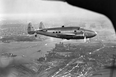 Howard Hughes Lockheed 14 Super Electra over New York City--Photographic Print