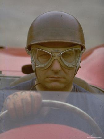 Argentine Auto Racer Juan Manuel Fangio Sitting at Wheel of Race Car at Las Mans