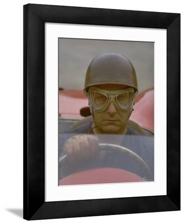 Argentine Auto Racer Juan Manuel Fangio Sitting at Wheel of Race Car at Las Mans