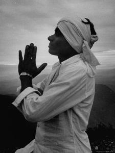 Buddhist Pilgrim Praying on Top of Sacred Mountain of Sri Pada in Ceylon by Howard Sochurek
