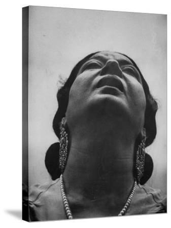 "Egyptian Actress Om Kalthoum, While Singing on Cairo's ""Voice of Arabs"" Radio Show"